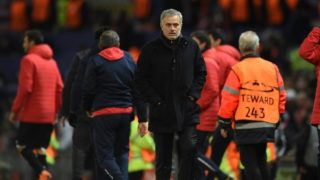 Manchester United's Portuguese manager Jose Mourinho leaves the pitch after losing a last 16 second leg UEFA Champions League football match between Manchester United and Sevilla at Old Trafford in Manchester, northwest England on March 13, 2018. / AFP PHOTO / Oli SCARFF