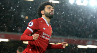 Liverpool's Egyptian midfielder Mohamed Salah celebrates scoring the team's fourth goal during the English Premier League football match between Liverpool and Watford at Anfield in Liverpool, north west England on March 17, 2018. / AFP PHOTO / Lindsey PARNABY / RESTRICTED TO EDITORIAL USE. No use with unauthorized audio, video, data, fixture lists, club/league logos or 'live' services. Online in-match use limited to 75 images, no video emulation. No use in betting, games or single club/league/player publications.  /