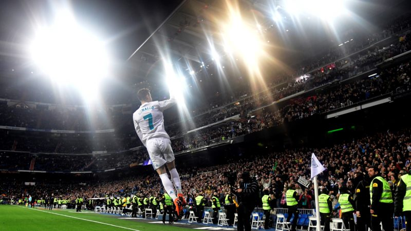 Real Madrid's Portuguese forward Cristiano Ronaldo celebrates a goal during the Spanish League football match between Real Madrid CF and Girona FC at the Santiago Bernabeu stadium in Madrid on March 18, 2018. / AFP PHOTO / JAVIER SORIANO