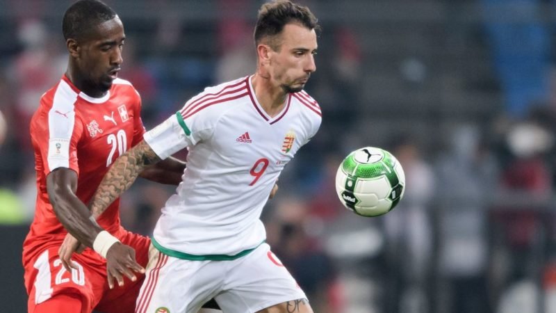 Swiss defender Johan Djourou (L) and Hungarian forward Roland Ugrai vie for the ball during the FIFA World Cup WC 2018 football qualifier match between Switzerland and Hungary at the St Jakob-Park Stadium on October 7, 2017 in Basel. / AFP PHOTO / Fabrice COFFRINI