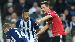 Manchester United's Spanish midfielder Ander Herrera (R) gestures to West Bromwich Albion's Irish midfielder James McClean during the English Premier League football match between West Bromwich Albion and Manchester United at The Hawthorns stadium in West Bromwich, central England, on December 17, 2017.  / AFP PHOTO / Oli SCARFF / RESTRICTED TO EDITORIAL USE. No use with unauthorized audio, video, data, fixture lists, club/league logos or 'live' services. Online in-match use limited to 75 images, no video emulation. No use in betting, games or single club/league/player publications.  /