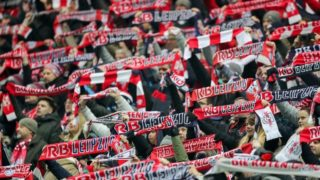Leipzig's fans hold up their fan scarves during the German Bundesliga soccer match between RB Leipzig and FC Schalke 04 at the Red Bull Arena in Leipzig, Germany, 13 Janaury 2018. Photo: Jan Woitas/dpa-Zentralbild/dpa