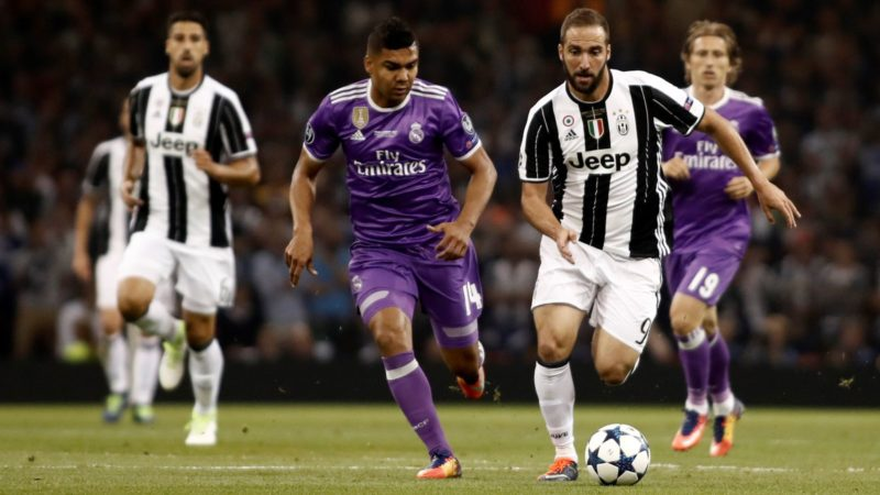 CARDIFF, WALES - JUNE 3: Gonzalo Higuain (2nd R) of Juventus in action against Carlos Casemiro (2nd L) of Real Madrid during of UEFA Champions League Final soccer match between Juventus and Real Madrid at Millennium Stadium in Cardiff, Wales on June 3, 2017. Burak Akbulut / Anadolu Agency