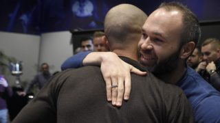 Barcelona's Argentinian defender Javier Mascherano (C-L) hugs Barcelona's Spanish midfielder Andres Iniesta during a farewell ceremony organised by the football club in Barcelona ahead of his transfter to China on January 24, 2018. Mascherano was unveiled as the latest big name to move to China, signing for Hebei China Fortune from Barcelona. / AFP PHOTO / LLUIS GENE