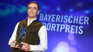 Retired soccer player Philipp Lahm holds his prize at the awards show of the Bavarian Sports Prize 2017 in Munich, Germany, 22 July 2017. The former Bayern Munich defender was awarded the personality prize by the Bavarian premier. Photo: Tobias Hase/dpa