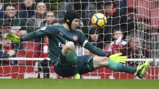 Arsenal's Czech goalkeeper Petr Cech makes a save during the English Premier League football match between Arsenal and Watford at the Emirates Stadium in London on March 11, 2018.  / AFP PHOTO / Ben STANSALL / RESTRICTED TO EDITORIAL USE. No use with unauthorized audio, video, data, fixture lists, club/league logos or 'live' services. Online in-match use limited to 75 images, no video emulation. No use in betting, games or single club/league/player publications.  /