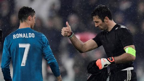 Juventus' Italian goalkeeper Gianluigi Buffon (R) congratulates Real Madrid's Portuguese forward Cristiano Ronaldo at the end of the UEFA Champions League quarter-final first leg football match between Juventus and Real Madrid at the Allianz Stadium in Turin on April 3, 2018. / AFP PHOTO / JAVIER SORIANO
