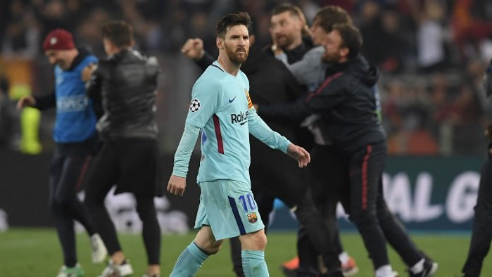 FC Barcelona's Argentinian forward Lionel Messi reacts after losing the UEFA Champions League quarter-final second leg football match between AS Roma and FC Barcelona at the Olympic Stadium in Rome on April 10, 2018. / AFP PHOTO / LLUIS GENE