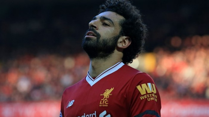 Liverpool's Egyptian midfielder Mohamed Salah gestures during the English Premier League football match between Liverpool and Bournemouth at Anfield in Liverpool, north west England on April 14, 2018. / AFP PHOTO / Lindsey PARNABY / RESTRICTED TO EDITORIAL USE. No use with unauthorized audio, video, data, fixture lists, club/league logos or 'live' services. Online in-match use limited to 75 images, no video emulation. No use in betting, games or single club/league/player publications.  /