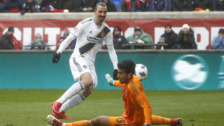 Richard Sanchez (R) of Chicago Fire defends a shot by Zlatan Ibrahimovic (L) of Los Angeles Galaxy during the first half of a MLS soccer match on April 14, 2018 at the Toyota Park in Bridgeview, Illinois.  / AFP PHOTO / Kamil Krzaczynski