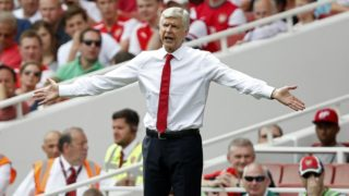 (FILES) In this file photo taken on August 09, 2015 Arsenal's French manager Arsene Wenger gestures during the English Premier League football match between Arsenal and West Ham United at the Emirates Stadium in London on August 9, 2015. Arsene Wenger will bring his 22-year stay in charge of Arsenal to a close at the end of the season, the Frenchman announced on April 20, 2018. / AFP PHOTO / Adrian DENNIS