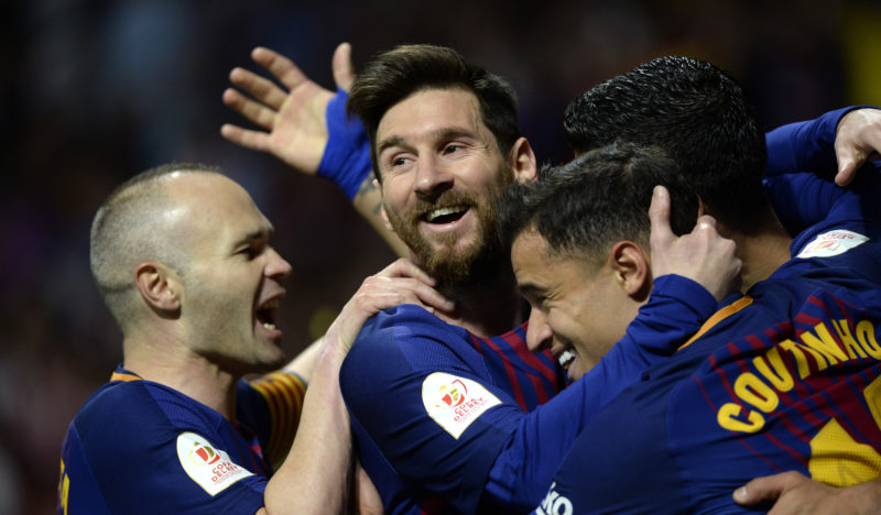 Barcelona's Uruguayan forward Luis Suarez (R) celebrates with Barcelona's Spanish midfielder Andres Iniesta, Barcelona's Argentinian forward Lionel Messi and Barcelona's Brazilian midfielder Philippe Coutinho after scoring during the Spanish Copa del Rey (King's Cup) final football match Sevilla FC against FC Barcelona at the Wanda Metropolitano stadium in Madrid on April 21, 2018.  / AFP PHOTO / CRISTINA QUICLER