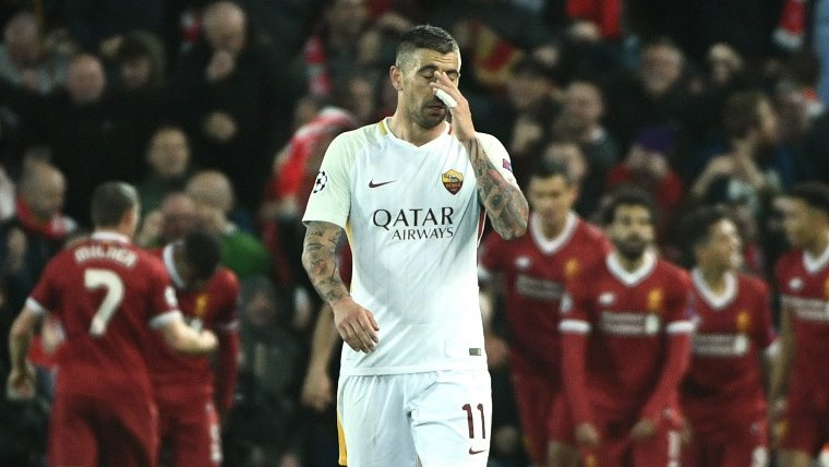 Roma's Croatian defender Aleksandar Kolarov reacts after Liverpool score their third goal during the UEFA Champions League first leg semi-final football match between Liverpool and Roma at Anfield stadium in Liverpool, north west England on April 24, 2018. / AFP PHOTO / Filippo MONTEFORTE