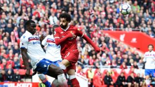 Stoke City's French defender Kurt Zouma (L) vies with Liverpool's Egyptian midfielder Mohamed Salah during the English Premier League football match between Liverpool and Stoke City at Anfield in Liverpool, north west England on April 28, 2018. / AFP PHOTO / Paul ELLIS / RESTRICTED TO EDITORIAL USE. No use with unauthorized audio, video, data, fixture lists, club/league logos or 'live' services. Online in-match use limited to 75 images, no video emulation. No use in betting, games or single club/league/player publications.  /