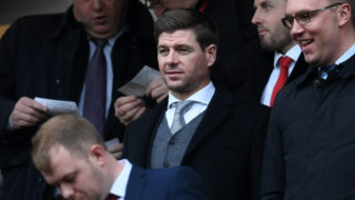 Former Liverpool player Steven Gerrard (C) takes his seat for the English Premier League football match between Liverpool and Burnley at Anfield in Liverpool, north west England on March 12, 2017. / AFP PHOTO / Paul ELLIS / RESTRICTED TO EDITORIAL USE. No use with unauthorized audio, video, data, fixture lists, club/league logos or 'live' services. Online in-match use limited to 75 images, no video emulation. No use in betting, games or single club/league/player publications.  /