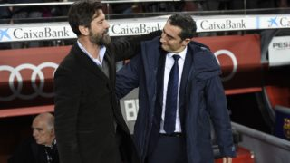 Barcelona's Spanish coach Ernesto Valverde (R) greets Espanyol's Spanish coach Quique Sanchez Flores ahead of the Spanish 'Copa del Rey' (King's cup) quarter-final second leg football match between FC Barcelona and RCD Espanyol at the Camp Nou stadium in Barcelona on January 25, 2018.  / AFP PHOTO / LLUIS GENE
