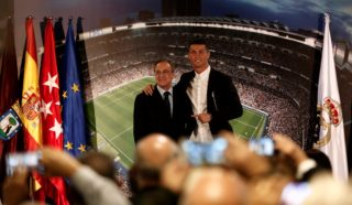 MADRID, SPAIN - NOVEMBER 07: Cristiano Ronaldo (R) stands next to Real Madrid president Florentino Perez (L) during his contract extension press conference at the Santiago Bernabeu Stadium in Madrid, Spain on November 07, 2016. Ronaldo extended contract with Real Madrid until 2021. Burak Akbulut / Anadolu Agency