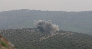 """ALEPPO, SYRIA - FEBRUARY 09: Smoke rises as Turkish soldiers and Free Syrian Army (FSA) fighters launch an operation to clear Muhammadiyah village and Amarah Hill of PYD/PKK terrorists in western Afrin region, as part of """"Operation Olive Branch"""" in Syria on February 12, 2018. Since the beginning of the operation, 51 different strategic areas have been captured from the clutches of terrorists, among them a town center, 33 villages, three rural areas and 14 hills. A total of 1,369 PKK/KCK/PYD-YPG and Daesh terrorists have been """"neutralized"""" since the launch of Operation Olive Branch in Syria's Afrin region.         Sariya Resit / Anadolu Agency"""