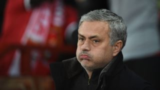 Manchester United's Portuguese manager Jose Mourinho looks on during the start of a last 16 second leg UEFA Champions League football match between Manchester United and Sevilla at Old Trafford in Manchester, northwest England on March 13, 2018. / AFP PHOTO / Oli SCARFF