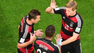 Germany's forward Miroslav Klose (L) celebrates with teammates Germany's midfielder Toni Kroos (R) and Germany's defender Jerome Boateng (C) after scoring the second goal during the semi-final football match between Brazil and Germany at The Mineirao Stadium in Belo Horizonte on July 8, 2014, during the 2014 FIFA World Cup.  AFP PHOTO / FRANCOIS XAVIER MARIT/POOL / AFP PHOTO / POOL / FRANCOIS XAVIER MARIT