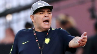Former Argentinian footballer and Fujairah FC manager Diego Armando Maradona reacts on the sidelines of a friendly match between his club and Egypt's Al-Ahly SC, at the Fujairah Football Club stadium in the Gulf emirate of the same name on March 27, 2018. / AFP PHOTO / KARIM SAHIB