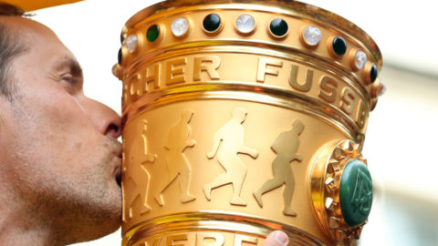 Coach Thomas Tuchel kisses the cup during celebrations aboard the team truck in Dortmund, Germany, 28 May 2017. Borussia Dortmund won the DFB-Cup final match against Eintrach Frankfurt 2-1 yesterday evening. Photo: Friso Gentsch/dpa
