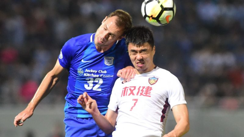 Hungarian football player Krisztian Vadocz, top, of Hong Kong's Kitchee SC heads the ball to make a pass against Zhao Xuri of China's Tianjin Quanjian FC in a Group E match during the 2018 AFC Champions League in Hong Kong, China, 4 April 2018.  Tianjin Quanjian powered into the knockout stages of the AFC Champions League after beating Hong Kong Kitchee 1-0 at Mongkok Stadium thanks to a late goal from Anthony Modeste here on Wednesday (4 April 2018). The Chinese Super League side has started the domestic season with only one win from its first four games, losing three straight matches entering the latest AFC Champions League tilt. While also competing in the AFC Champions League group stage for the first time, Kitchee started the group stage suffering three straight defeats and then went on to make history by serving up a tasty upset against J-League side Kashiwa Reysol last month. Quanjian almost took the lead in the 19th minute when Axel Witsel pulled his trigger in the box, but only saw the ball missed the target. The home side then settled into the match to create chances of their own as star man Diego Forlan stinging the palms of Zhang Lu after 34 minutes. Both sides wasted chances and went into the half time break locked at 0-0. Early in the second half, Kitchee came up with two clear chances to get in front. However, efforts from Krisztian Vadocz and Azevedi Aygysto both failed to hit the intended target. Just when the match looked headed for a goalless stalemate, Modeste scored with a header from close range with just a minute of regulation time remaining. The 1-0 score stood towards the final whistle, as Quanjian sealed a spot in the round of 16 and leaves open the possibility of finishing top of Group E should they defeat Kashiwa Reysol in their final match and Kitchee defeat Jeonbuk Hyundai Motors in the other match.