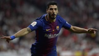 Barcelona's Uruguayan forward Luis Suarez celebrates after scoring during the Spanish Copa del Rey (King's Cup) final football match Sevilla FC against FC Barcelona at the Wanda Metropolitano stadium in Madrid on April 21, 2018.  / AFP PHOTO / CRISTINA QUICLER