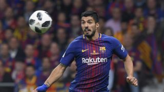 Barcelona's Uruguayan forward Luis Suarez eyes the ball during the Spanish Copa del Rey (King's Cup) final football match Sevilla FC against FC Barcelona at the Wanda Metropolitano stadium in Madrid on April 21, 2018.  / AFP PHOTO / LLUIS GENE