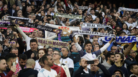 Real Madrid fans hold up scarves before the UEFA Champions League semi-final second leg football match between Real Madrid and Bayern Munich at the Santiago Bernabeu Stadium in Madrid on May 1, 2018. / AFP PHOTO / JAVIER SORIANO