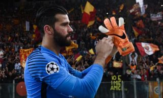 Roma's Brazilian goalkeeper Alisson acknowledges fans at the end of the UEFA Champions League semi-final second leg football match between AS Roma and Liverpool at the Olympic Stadium in Rome on May 2, 2018. / AFP PHOTO / Filippo MONTEFORTE