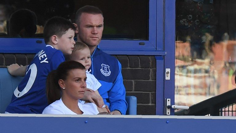 Everton's English striker Wayne Rooney watches from the stands with wife Colleen and children during the English Premier League football match between Everton and Southampton at Goodison Park in Liverpool, north west England on May 5, 2018. / AFP PHOTO / Paul ELLIS / RESTRICTED TO EDITORIAL USE. No use with unauthorized audio, video, data, fixture lists, club/league logos or 'live' services. Online in-match use limited to 75 images, no video emulation. No use in betting, games or single club/league/player publications.  /