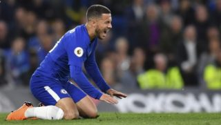 Chelsea's Belgian midfielder Eden Hazard reacts after a challenge during the English Premier League football match between Chelsea and Huddersfield Town at Stamford Bridge in London on May 9, 2018. / AFP PHOTO / Ben STANSALL / RESTRICTED TO EDITORIAL USE. No use with unauthorized audio, video, data, fixture lists, club/league logos or 'live' services. Online in-match use limited to 75 images, no video emulation. No use in betting, games or single club/league/player publications.  /