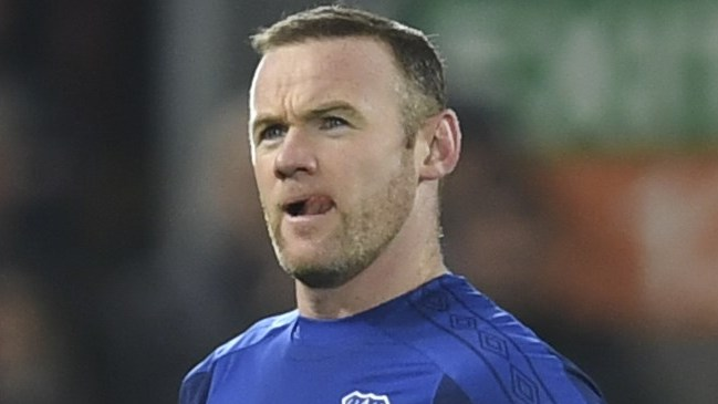 """(FILES) In this file photo taken on January 05, 2018 Everton's English striker Wayne Rooney starts to leave the pitch as he sees his number come up for substitution during the English FA Cup third round football match between Liverpool and Everton at Anfield in Liverpool, north west England on January 5, 2018. Wayne Rooney has agreed a """"deal in principle"""" to join Major League Soccer side DC United from Premier League club Everton, reports said on May 10, 2018. It has been suggested a Ł12.5 million ($17 million) deal has been agreed that could see the 32-year-old leave his boyhood club just 12 months after rejoining them from Manchester United.  / AFP PHOTO / Paul ELLIS / RESTRICTED TO EDITORIAL USE. No use with unauthorized audio, video, data, fixture lists, club/league logos or 'live' services. Online in-match use limited to 75 images, no video emulation. No use in betting, games or single club/league/player publications.  /"""