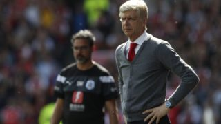Arsenal's French manager Arsene Wenger looks on during the English Premier League football match between Huddersfield Town and Arsenal at the John Smith's stadium in Huddersfield, northern England on May 13, 2018. / AFP PHOTO / Adrian DENNIS / RESTRICTED TO EDITORIAL USE. No use with unauthorized audio, video, data, fixture lists, club/league logos or 'live' services. Online in-match use limited to 75 images, no video emulation. No use in betting, games or single club/league/player publications.  /