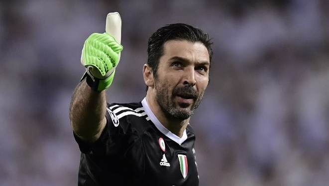 (FILES) In this file photo taken on April 11, 2018 Juventus' Italian goalkeeper Gianluigi Buffon gives the thumb up during the UEFA Champions League quarter-final second leg football match between Real Madrid CF and Juventus FC at the Santiago Bernabeu stadium in Madrid. Juventus goalkeeper Gianluigi Buffon announced on May 17, 2018 that he will leave the Turin giants after 17 years. Buffon, 40, captained Juventus to a seventh straight Serie A title and fourth consecutive Italian Cup triumph this season.  / AFP PHOTO / JAVIER SORIANO