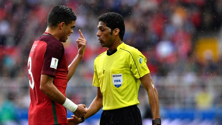 Portugal's defender Pepe (L) gestures at Saudi referee Fahad Al Mirdasi during the 2017 FIFA Confederations Cup third place football match between Portugal and Mexico at the Spartak Stadium in Moscow on July 2, 2017. / AFP PHOTO / Alexander NEMENOV