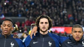 (L-R) France's forward Anthony Martial, France's midfielder Adrien Rabiot and France's forward Kylian Mbappe stand for the national anthem prior to the international friendly football match Germany against France in Cologne on November 14, 2017. / AFP PHOTO / John MACDOUGALL