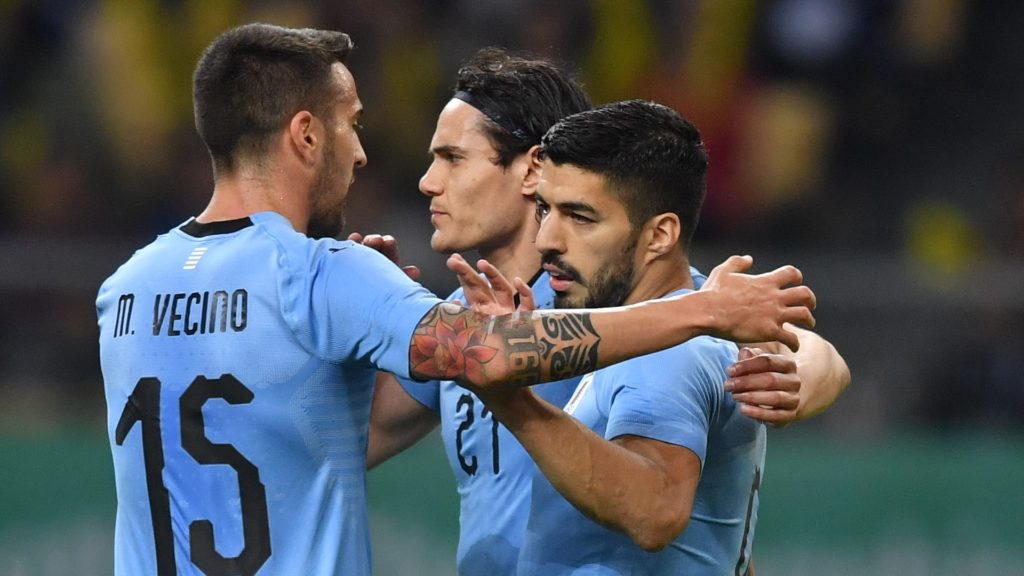 Luis Suarez, right, of Uruguay national football team celebrates with his teammates after scoring against Czech Republic national football team in their semi-final match during the 2018 Gree China Cup International Football Championship in Nanning city, south China's Guangxi Zhuang Autonomous Region, 23 March 2018.  Luis Suarez and Edison Cavani's goals helped Uruguay beat Czech Republic 2-0 in the China Cup 2018 here on Friday (23 March 2018) night. Uruguay will play Wales in the final of the tournament on March 26. Suarez was brought down by Czech Republic's goalkeeper Jiri Pavlenka in the 10th minute, and he decided to take it on his own. The Uruguayan beat the goalkeeper and made the score 1-0. Uruguay extended the lead to 2-0 in the 38th minute, when Cavani received a pass from Suarez and scored with a spectacular bicycle kick. Czech Republic didn't want to give up easily, and they created several chances in the second half, but Patrik Schick's shot from close range was denied by the bar. Neither side was able to change the score sheet in the rest of the game. Therefore Uruguay goes into the final and will play Wales on March 26, while Czech Republic will meet hosts China in the third-place playoff on the same day.
