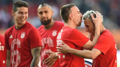 07 April 2018, Germany, Augsburg, Soccer: Bundesliga, FC Augsburg vs FC Bayern Munich, in the WWK Arena. Munich's James Rodriguez (L-R), Arturo Vidal, Franck Ribery and Rafinha after the game. Munich has one its 28th bundesliga and, after their 4:1 win today, have won the title with still 5 matches to go. Photo: Andreas Gebert/dpa - IMPORTANT NOTICE: Due to the German Football League·s (DFL) accreditation regulations, publication and redistribution online and in online media is limited during the match to fifteen images per match