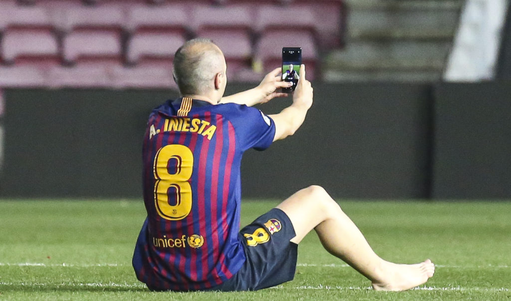 FC Barcelona midfielder Andres Iniesta (8) alone in the grass of Camp Nou says goodbye to the stadium after playing his last game with FC Barcelona. after the match between FC Barcelona against Real Sociedad, for the round 38 of the Liga Santander, played at Camp nou  on 20th May 2018 in Barcelona, Spain. (Photo by Urbanandsport/NurPhoto)