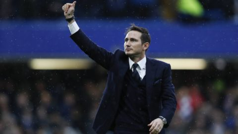 Chelsea and England former football player Frank Lampard gestures to the fans on the pitch at half-time during the English Premier League football match between Chelsea and Swansea at Stamford Bridge in London on February 25, 2017. / AFP PHOTO / Adrian DENNIS / RESTRICTED TO EDITORIAL USE. No use with unauthorized audio, video, data, fixture lists, club/league logos or 'live' services. Online in-match use limited to 75 images, no video emulation. No use in betting, games or single club/league/player publications.  /
