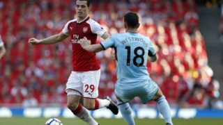 Arsenal's Swiss midfielder Granit Xhaka (L) vies with Burnley's English midfielder Ashley Westwood during the English Premier League football match between Arsenal and Burnley at the Emirates Stadium in London on May 6, 2018.  / AFP PHOTO / IKIMAGES / Ian KINGTON / RESTRICTED TO EDITORIAL USE. No use with unauthorized audio, video, data, fixture lists, club/league logos or 'live' services. Online in-match use limited to 45 images, no video emulation. No use in betting, games or single club/league/player publications.  /