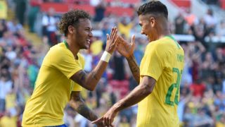 Brazil's striker Roberto Firmino (R) celebrates with Brazil's striker Neymar after scoring their second goal during the International friendly football match between Brazil and Croatia at Anfield in Liverpool on June 3, 2018. Brazil won the game 2-0. / AFP PHOTO / Oli SCARFF