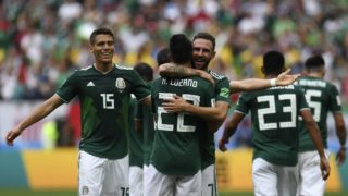 Mexico's forward Hirving Lozano (front C) is congratulated by Mexico's defender Miguel Layun (rear C) as he celebrates with teammates after scoring a goal during the Russia 2018 World Cup Group F football match between Germany and Mexico at the Luzhniki Stadium in Moscow on June 17, 2018. / AFP PHOTO / Patrik STOLLARZ / RESTRICTED TO EDITORIAL USE - NO MOBILE PUSH ALERTS/DOWNLOADS