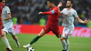 5534443 15.06.2018 Portugal's Cristiano Ronaldo, centre, and Spain's Nacho struggle for a ball during the World Cup Group B soccer match between Portugal and Spain at the Fisht stadium in Sochi, Russia, June 15, 2018. Grigoriy Sisoev / Sputnik