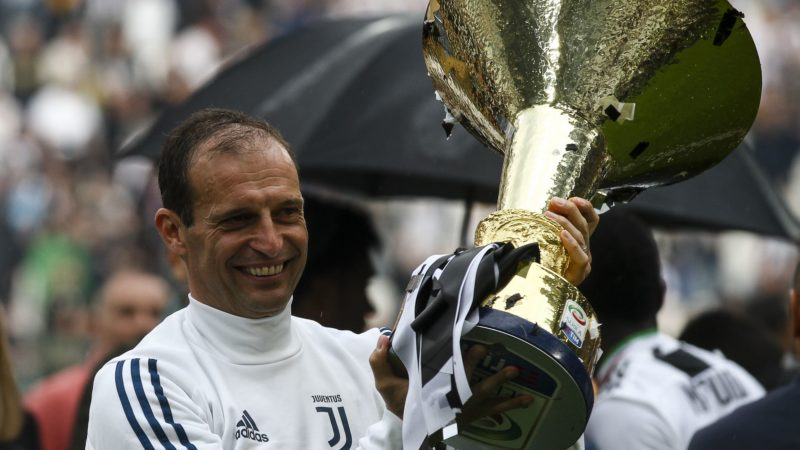 Juventus coach Massimiliano Allegri celebrates holding the Serie A soccer title trophy after the Serie A football match n.38 JUVENTUS - VERONA on 19/05/2018 at the Allianz Stadium in Turin, Italy. (Photo by Matteo Bottanelli/NurPhoto)