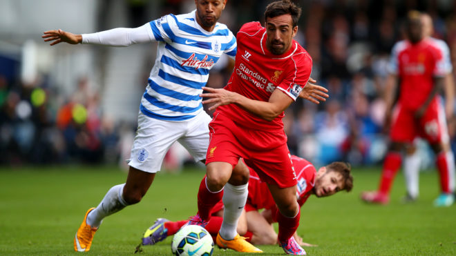 LONDON, ENGLAND - OCTOBER 19:  Jose Enrique of Liverpool runs with the ball past Matt Phillips of QPR during the Barclays Premier League match between Queens Park Rangers and Liverpool at Loftus Road on October 19, 2014 in London, England.  (Photo by Clive Rose/Getty Images)