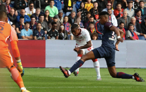 PARIS, FRANCE - SEPTEMBER 30:  Malcom of FC Girondins de Bordeaux in action with Presnel Kimpembe of PSG during the Ligue 1 match between Paris Saint-Germain (PSG) and FC Girondins de Bordeaux at Parc des Princes on September 30, 2017 in Paris.  (Photo by Xavier Laine/Getty Images )