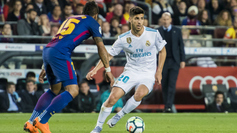 BARCELONA, SPAIN - MAY 06: Marco Asensio Willemsen (R) of Real Madrid battles for the ball with Jose Paulo Bezerra Maciel Junior, Paulinho, of FC Barcelona during the La Liga match between Barcelona and Real Madrid at Camp Nou on May 6, 2018 in Barcelona, Spain. (Photo by Power Sport Images/Getty Images)